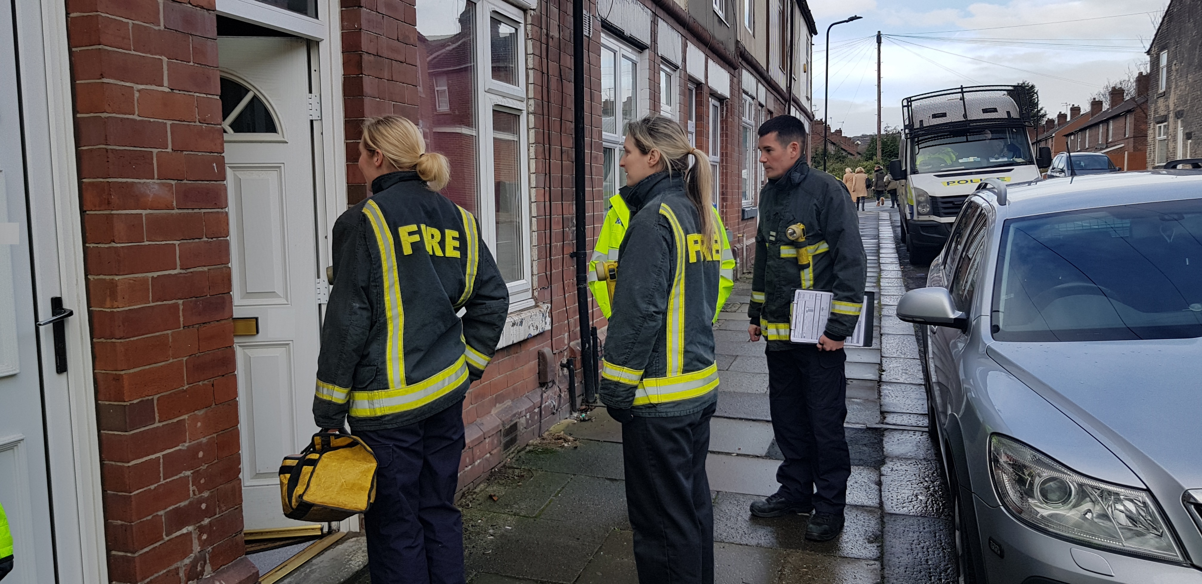 South Yorkshire Fire and Rescue colleagues safety checking homes