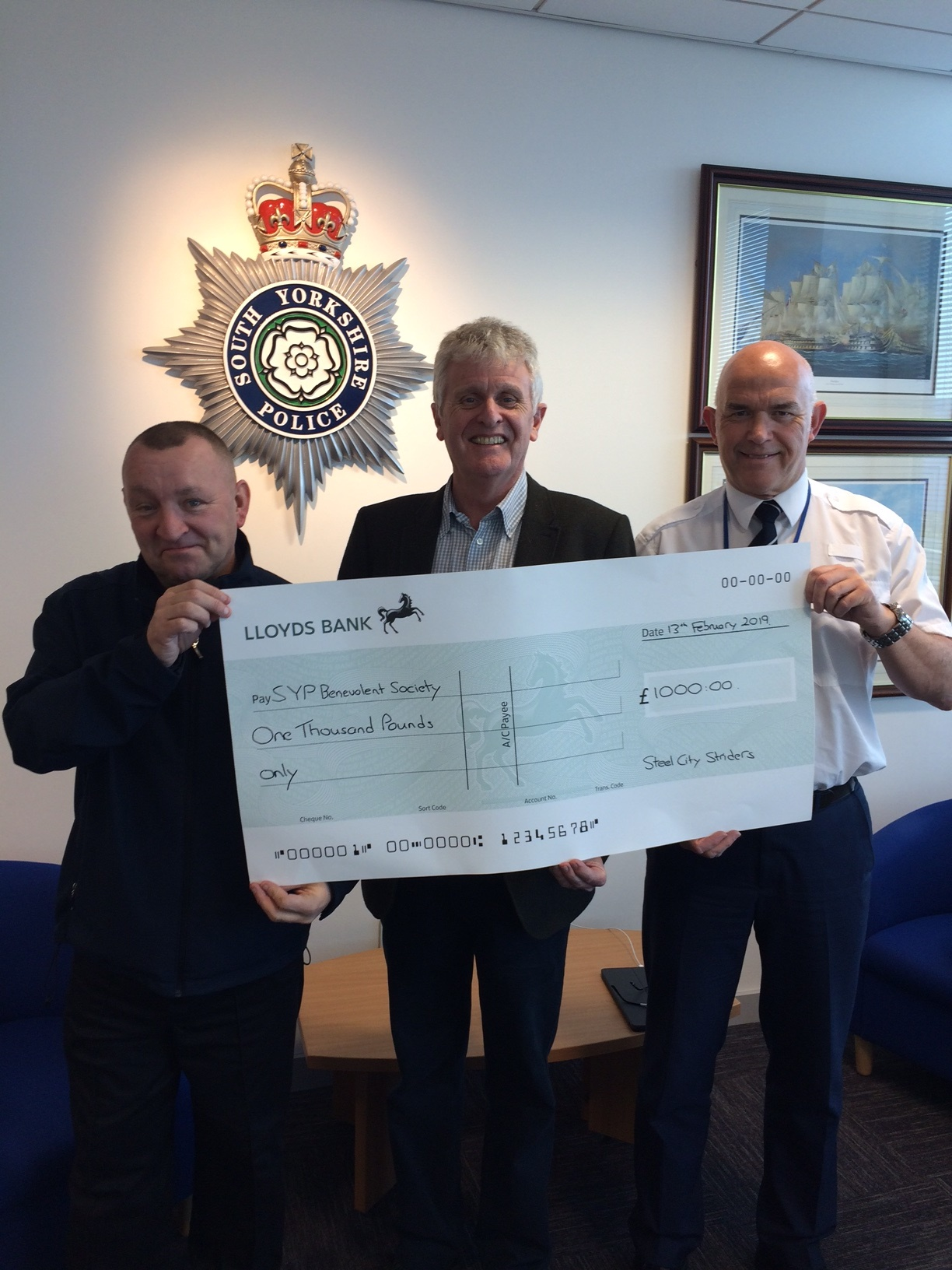 Richard Dunk, event organiser, presents £1,000 donation to Robert Dyson of SYP Benevolent Society and Clive Palmer of SYP